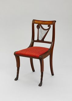 1810-1820 American (New York) Side chair at the Metropolitan Museum of Art, New York - Note how the chair back has been carved with the image of a harp - and an asymmetrical one at that.