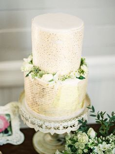Such a beautiful wedding cake - with love notes decorating the bottom tier!