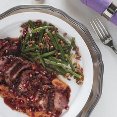 Roast Duck Breasts with Pomegranate-Chile Sauce.  In beans used thyme in place of rosemary.  Made sauce as stated except no adobe as could not find and reduced pom and stock to half to get a jam almost,  hash with leftovers in am was excellent.
