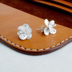 Beautiful silver hibiscus flower stud earrings, handcrafted by skilled artisans.