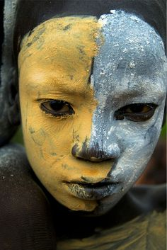 Africa | Suri child with face painted. Omo Valley, Ethiopia | ©Trevor Cole
