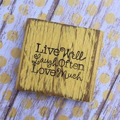 Live Well, Laugh Often, Love Much - Distressed Wood Block - Recycled Wood Measurements: 3 1/2 X 2 1/2 This sign is painted black with silver print. Check out our Facebook page for Giveaways!!! https://www.facebook.com/pages/Higgi-House/1418615955020258 If you live in Hawaii or Alaska please contact us for shipping costs. Thank you for shopping HiggiHouse.