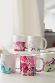 DIY Marbeled Nail Polish Coffee Mugs Tutorial -- make these beautiful mugs with nail polish and water! #diy #crafts