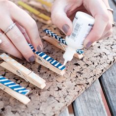 Dress up ordinary clothespins to spruce up your office space and hostess gifts with funky spring colors + patterns.