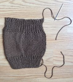 These sweet little mitts are easy to make – great for beginning knitters –  and will keep your hands toasty while your fingers keep typing. If you've  ever tried to type in a cold office or house you'll know the value of a  pair of fingerless hand covers. These are more simple than fingerless