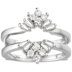 This wedding ring guard has a combination of round and baguette stones set with prongs. It is the perfect ring guard for any shape solitaire. Crafted of platinum with 2/5 carat of diamonds, the ring is polished to a radiant shine.