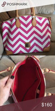 Dooney & Bourke handbag Pink and white chevron dooney handbag. Great condition no flaws. Longer strap included   The strap has still in the plastic Dooney & Bourke Bags Satchels
