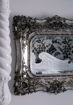 Embellished silver mirror.
