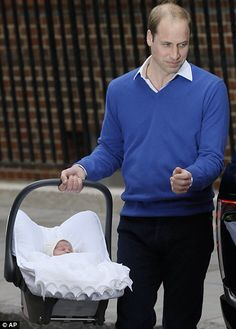 Prince William carries his newborn baby daughter in her car seat to their family car before strapping her safely in the back to return to Kensington Palace.