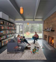 Love the large fireplace and brick wall...Mid-century modern remodel in Massachusetts opens to the outdoors