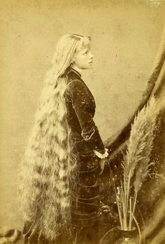 Girl with long hair.  It was a fad in the late Victorian era to grow hair as long as possible.