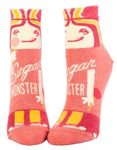 """Ain't she sweet? Pink socks with a girl holding a lollipop and the words: """"Sugar monster."""" Below the foot are the words: """"more please."""" Fits women's shoe size 5-10, above the ankle."""