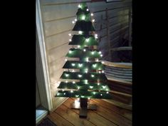 Hurry! before the season is over, get your front porch or den fashionable with this pallet wood christmas tree! Size is ~42 tall by 24 wide by 12 deep. Painted a christmas tree green on the top, and brown for the trunk, (christmas lights not included)  If you would like a similar design, we can change it up a bit to meet your needs!  Be sure to choose express shipping if you need it ASAP