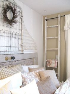 Reused ladder, old door for head board, old bed frame for wall decor. Flea market chic