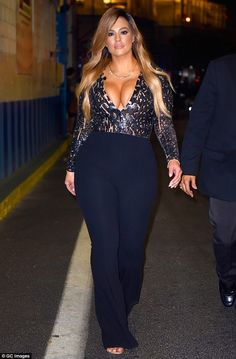 Jaw-dropping:The model, 28, showed off her ample cleavage for all to see in an daringly low-cut outfit as she headed to Chelsea Piers