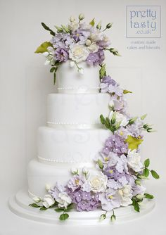 Floral cascade with roses, lisianthus and hydrangeas. #prettytasty.co.uk #wedding #cake