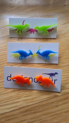 T-Rex, Triceratops and Parasaurolophus Earrings. Gold and Coloured Perspex. Piercings, Tiny Dinosaur, Dinosaur Silhouette, Gravure Laser, Dinosaur Earrings, Lazer Cut, Laser Cut Jewelry, Laser Cut Acrylic, T Rex