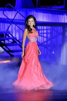 So during a pageant how do you walk in an evening gown? Well, your hands should be down by your side with the palm of your hands pointing at your thighs. As you are walking, it is perfectly fine to swing your arms just a little bit. Relax those shoulders and keep your chin held high. Read more...