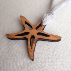 A personal favorite from my Etsy shop https://www.etsy.com/listing/218484965/wood-cutout-starfish-pendant-necklace