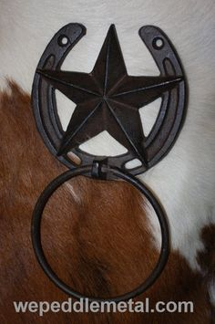 "Country Western bath decor featuring a towel ring with a Lone Star design. Size is 8 1/2"" tall x 4 7/8"" wide. The diameter on the ring is 4 1/4"". There are two holes for mounting. We do not provide an"