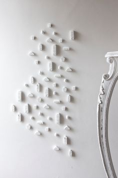 Clay Architecture Wall Installation - Ceramic clay houses by Artisanie Europe.  I think these are amazing!!