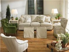 """Shop for Vanguard Living Room Sets, ABC_RS_2, and other Living Room Sets at Vanguard Furniture in Conover, NC. V256-CH - Brooks Chair. Body-Collins Sandstone with optional #9 Natural Nail Trim Spaced 1"""" on Outarms and Base, Finish- TrinidadV420-OT - Baxley Ottoman."""