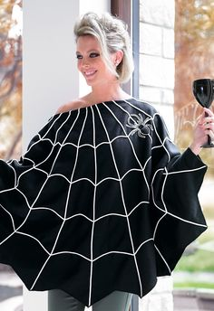 Slip our Spider Web Poncho over any outfit for an instant costume, or just wear it as a finishing touch.