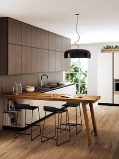 A Guide to Efficient Small Kitchen Design for Apartment Having limited space in an apartment doesn't mean you don't deserve a nice kitchen. See what a small kitchen design is all about. Peninsula Kitchen Design, Kitchen Bar Design, Interior Design Kitchen, Kitchen Layout, Island Design, Table Design, Küchen Design, Design Ideas, Bar Designs