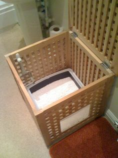 I wonder if my picky cat would go in the little door... DIY hidden litter box from IKEA Hackers: A Hol for kitty