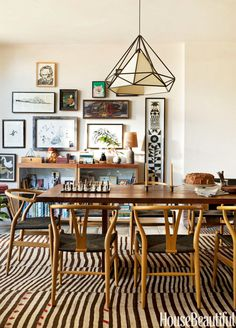 "A beloved dining table was resized by its maker, Alma Allen, to fit the dining room in this Los Angeles house. ""It's been with them forever, which we love,"" says designer Pamela Shamshiri. Hans Wegner's Wishbone chairs pick up on the Asian sensibility. Hanging lantern from Lawson-Fenning. Vintage patchwork rug from Lawrence of La Brea."