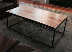 """Steel and Cherry coffee table.  25""""x50""""x17"""". Made by 5&2 Woodworks."""