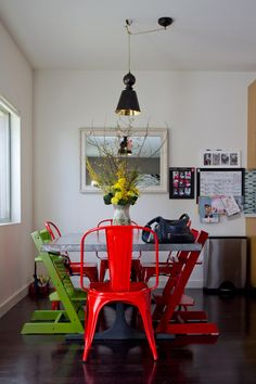 Really like how the high chairs blend in and look like regular chairs.  Very modern.  From Apartment Therapy blog.