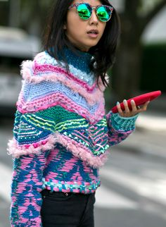 Street Style: The Best Fall Fashion from Milan Fashion Week 2015 | Crazy, quirky neon + pastel knit sweater, ombré pastel nails, and round mirrored green sunglasses