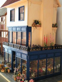 flower shop bij joep suijker, I wished someone who pinned this, had mentioned the site, because Joep Suijker is a very talented maker of miniature flowers.