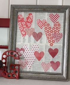 Simple... hearts from scrapbook paper and backed by old book pages, maybe love poems? #valentine