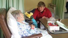 Denise bringing flowers for Glenda.