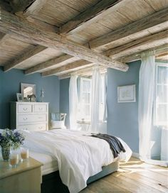 Blue, white, natural wood beams and ceiling, white curtains, natural lighting