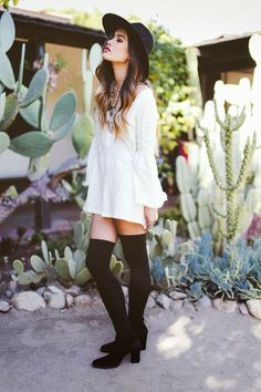 White lace dress and over the knee boots.