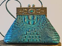 Satchel in rich turquoise gator leather with sterling silver concho magnet closure and shoulder strap