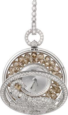 CARTIER. High Jewellery secret hour elephant décor pocket and pendant watch, quartz movement, calibre 058. Rhodium-finish 18K white gold case and pendant set with 63 briolette-cut brown diamonds totalling 9.42cts, 5 rose-cut brown diamonds, 1 brown diamond eye, brilliant-cut diamonds, silvered translucent lacquered sunray effect dial, 1 brilliant-cut diamond hour marker at 12 o'clock, rhodium-finish 18K white gold sword-shaped hands. Water-resistant to 3 bar (approx. 30 metres). Unique…