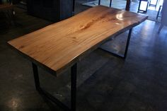 I think I saw this table (or its look-alike) at the penthouse suite of The Vue in Orlando. ^__^  Live Edge Reclaimed Wood Dining Table  White Elm by robrray, $2975.00