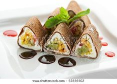 Dessert Maki Sushi - Chocolate Roll with Various Fruit and Cream Cheese inside. Chocolate Pancake outside. Served with Chocolate Sauce