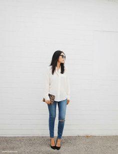 white silk blouse / ripped skinnies / black heels / leopard clutch