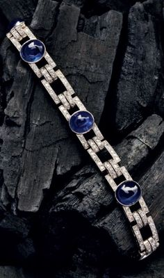 An Art Deco cabochon sapphire and diamond bracelet, mounted in platinum, French. Source: Humphrey Butler, 2015-16 catalogue. #antiquebracelets