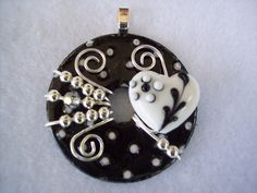 Beautiful Black and White Wire Wrapped and Beaded Washer Pendant. $21.00, via Etsy.
