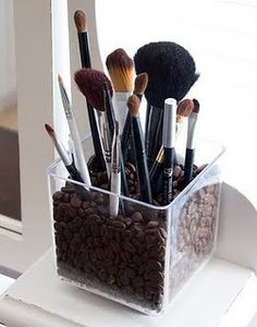 Okay, I've heard of storing make-up brushes upright in a jar or container of marbles but here's another idea using coffee beans. The smell may even help wake you up in the morning.