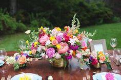 Modern wedding table arrangement of colorful flowers