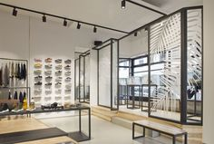 The industrial parquet-floor builds the base for the dark powdered steel-furniture. In addition to that, the store layout works with special brass gaps, showcases which are sunken in the floor and flexible presentation-systems in the shop-windows.