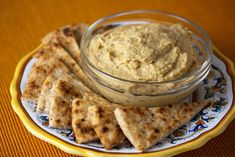 Mediterranean-Inspired Hummus - Not your ordinary hummus! This rich creamy Mediterranean-inspired hummus dip features a lively blend of chickpeas, cucumber, tahini paste, fresh lemon juice, garlic, cilantro, and olive oil blended together into a velvety smooth and delicious dip.