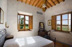 ~ rather sparse, but the exposed wood ceiling and hand-plastered walls offer plenty of character. Perfect guestroom.
